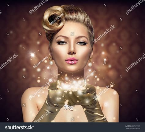 holiday retro woman blowing magic dust in her hand beauty
