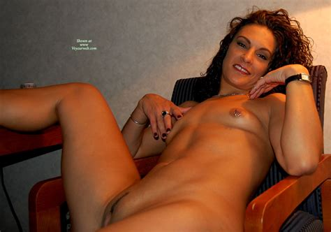 Naked Brunette In Chair With Pierced Nipples July 2008 Voyeur Web Hall Of Fame
