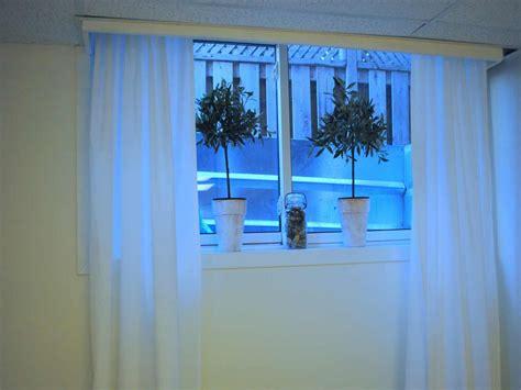 white kitchen cabinet  blue backsplash small curtains