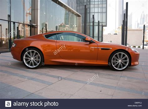 Burnt Orange Aston Martin Virage Luxury Sports Car Stock