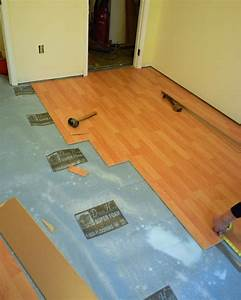 How to install a laminate floor how tos diy for How to lay down laminate flooring