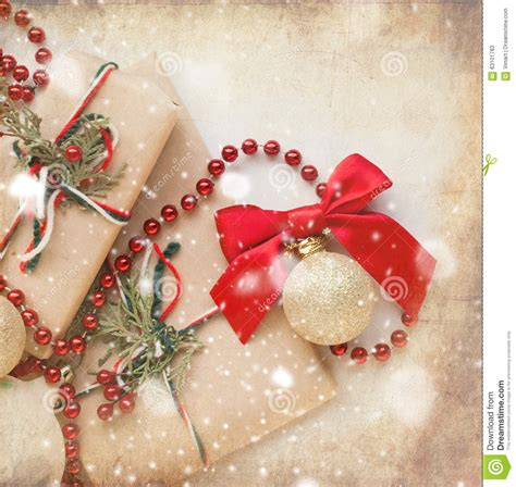 silver christmas balls and gifts on wooden table stock