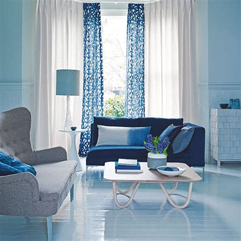 blue living room with patterned curtains decorating