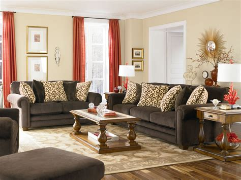 Living Room Red And Creem Colour Curtains With Brown And Cream Colour Sofa