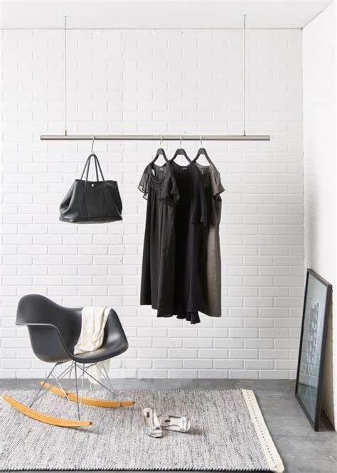 how to make hanging clothes rack interior design idea coat racks that hang from the ceiling contemporist