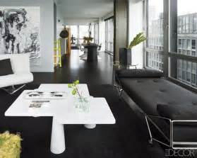 amazing mid century living room with black sofa bed and