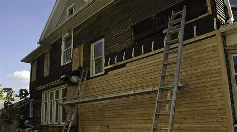 home renovation repairing  replacing clapboard