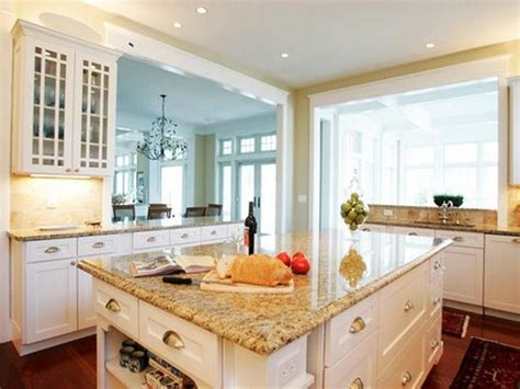 lovely white cabinets  yellow granite countertops