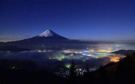 nature landscape starry night mountain cityscape mist