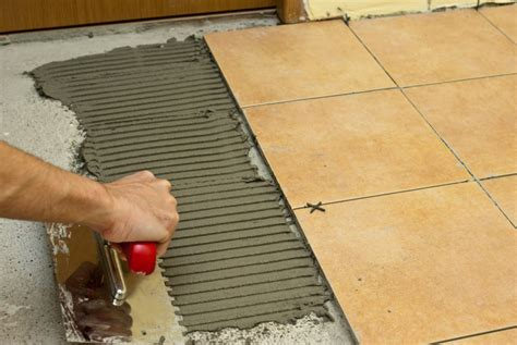 tile flooring glue how to spread tile adhesive howtospecialist how to build step by step diy plans