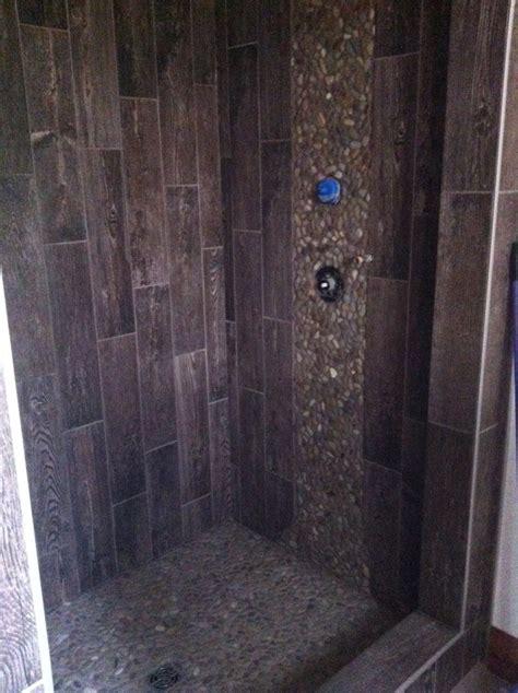 outhouse shower   porcelain tile  pebble