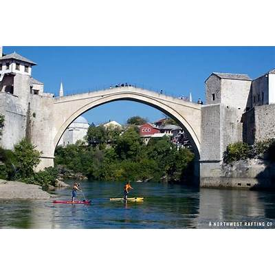 Paddleboarding through the Stari Most in Bosnia