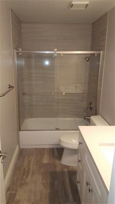 shades  gray tub shower  porcelain tile brushed