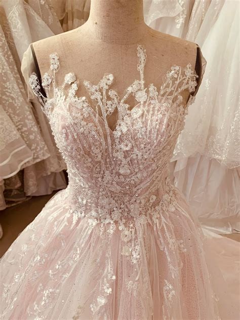 pastel light pink sleeveless lace applique ball gown
