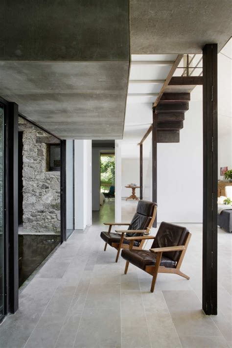 spanish stable turned contemporary stone home modern