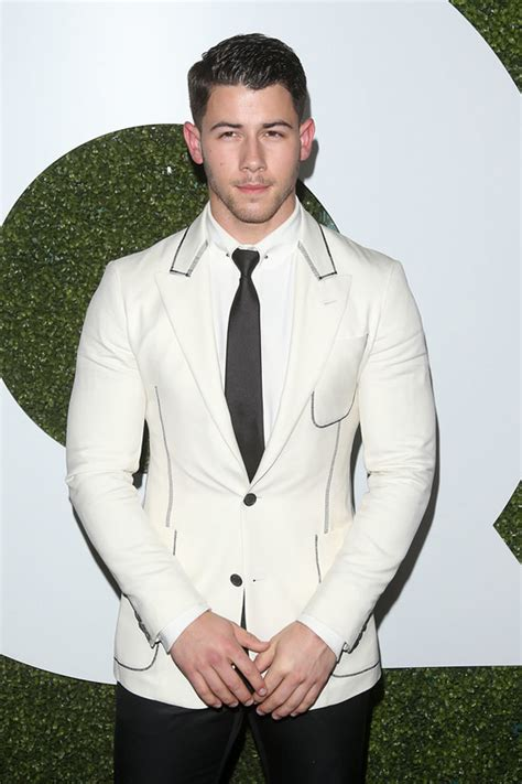 credit where it s due nick jonas almost looks pretty good at the gq men of the year party tom