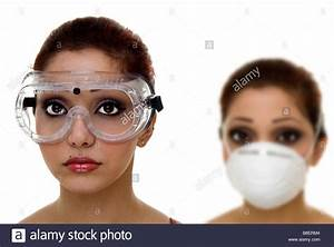women wearing safety goggles and dust mask Stock Photo ...