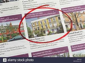 Houses for sale ads circled in newspaper, London, England ...