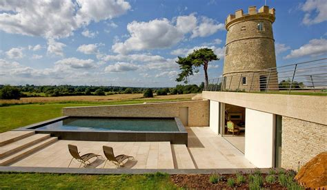 tower  folly    spectacular cotswolds home  swimming pool  servants annex  sale   million homes