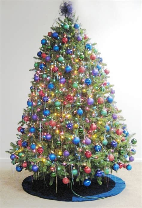 white christmas tree with purple and blue decorations