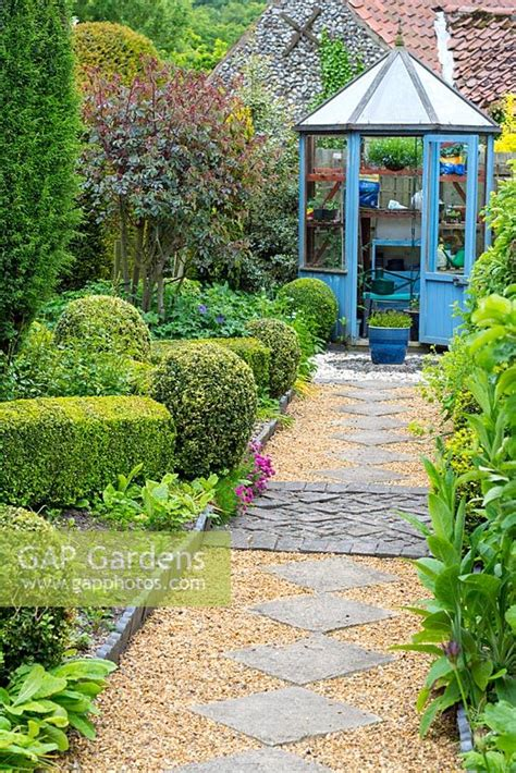 GAP Gardens  Cottage garden with slab and shingle path