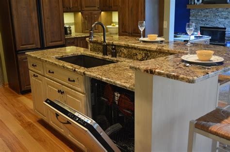 kitchen island with sink and dishwasher and seating dishwasher and sink in the island