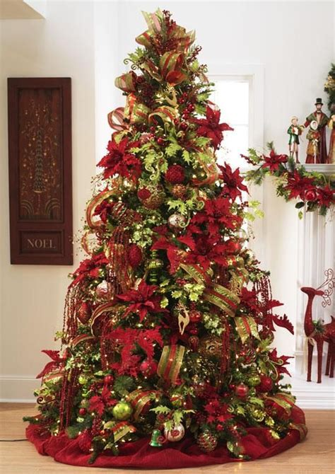 beautiful christmas tree featuring red green  gold