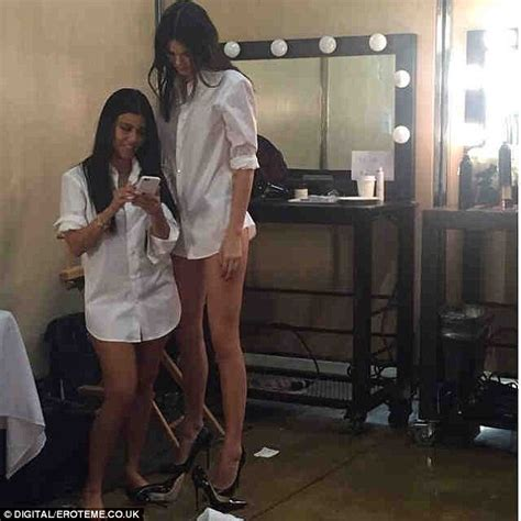 kendall jenner towers over sister kourtney kardashian in new snap daily mail online