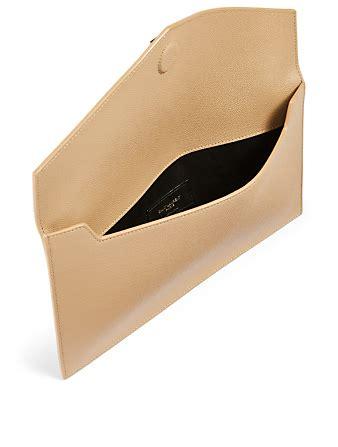 saint laurent medium uptown ysl monogram leather envelope clutch bag holt renfrew