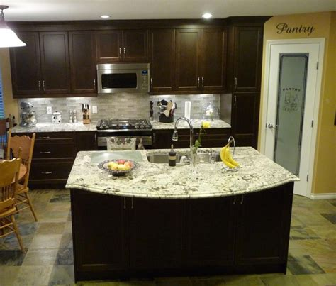 moon white granite with dark cabinets heritage west interiors ltd custom cabinetry