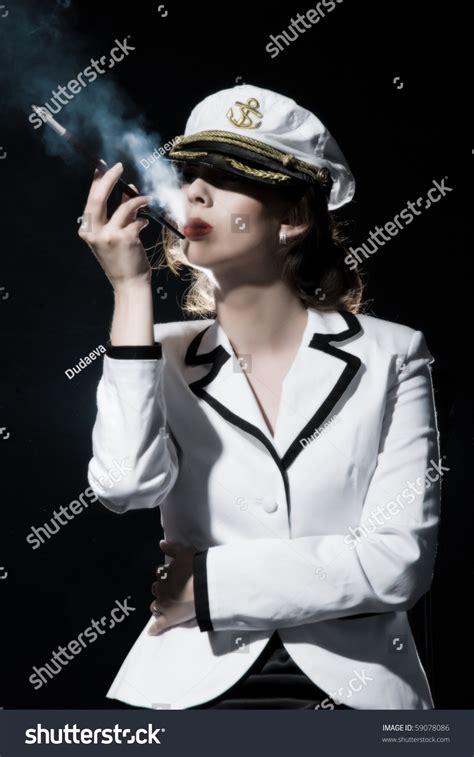 captain form beautiful girl captains form smoking cigarette stock photo