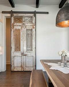 antique french doors and transom used to create a sliding With barn door style french doors