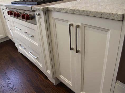 white solid wood custom kitchen  ivory granite
