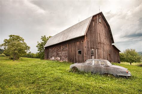 pictures of barns rustic car and barn photograph by gary heller
