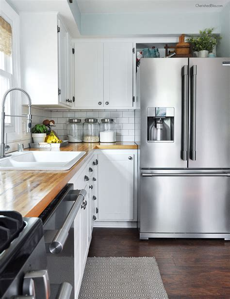 how to decorate the top of your kitchen cabinets how to decorate organize the top of your fridge tips
