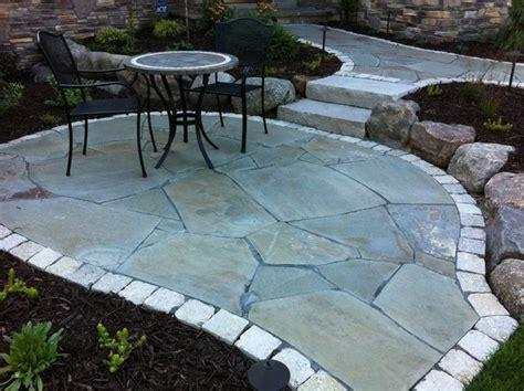 irregular flagstone front walkway and small sitting patio