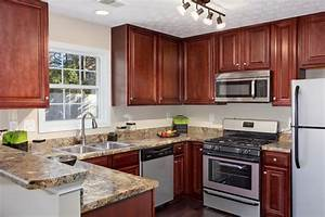 Light Kitchen With U Shaped Cherry Oak Cabinet And