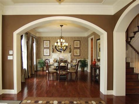 neutral traditional dining room  dramatic archway hgtv