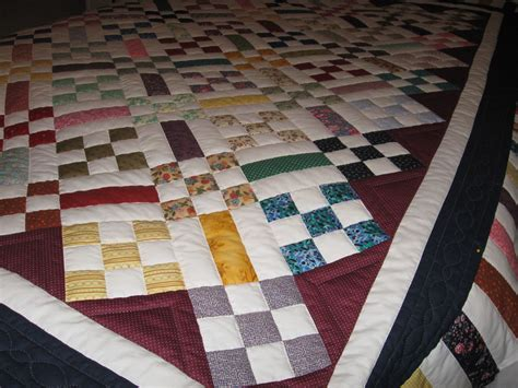 This Scrappy Rail Fence And Nine-patch Was Quilted By My