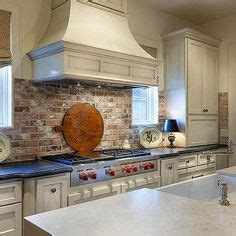 kitchen backsplash mirror brick wall in kitchen with white cabinets glass cabinet 2233