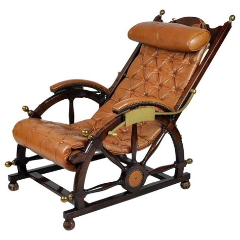 mahogany and brass deck chair set on ship wheel