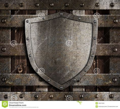 aged metal shield  wooden medieval gates stock photo