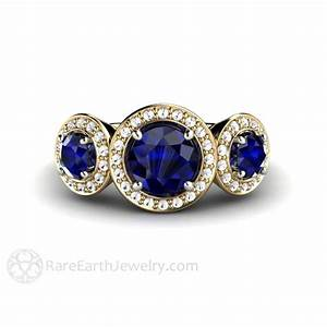 blue sapphire engagement ring with diamond halo round cut With wedding rings with blue stones
