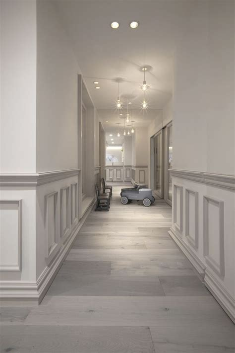 muted grey white toned wainscoting adds  world charm