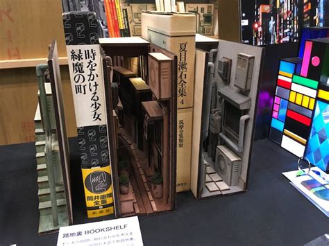 unique wooden bookends transform dioramae  tokyos