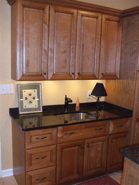 off white cabinets with brown glaze paint glazed kitchen cabinets with white and brown decor