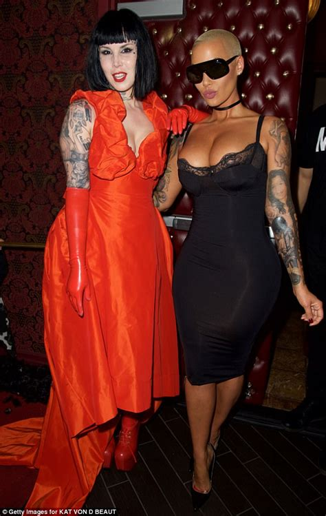 amber rose pours  curves  skintight lace dress