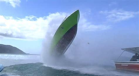 Small Boat Large Waves by Wave Hits Boat At Teahupoo