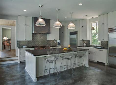 light gray kitchen cabinets  dark gray subway tile