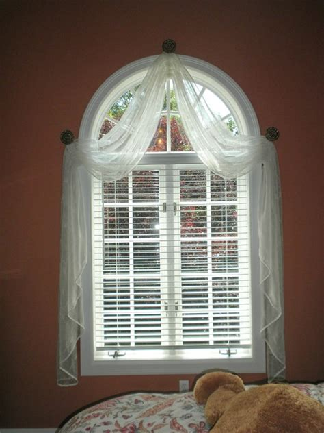 window treatments  arched windows  grasscloth